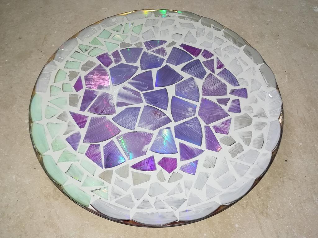 Reinigen des Mosaiks
